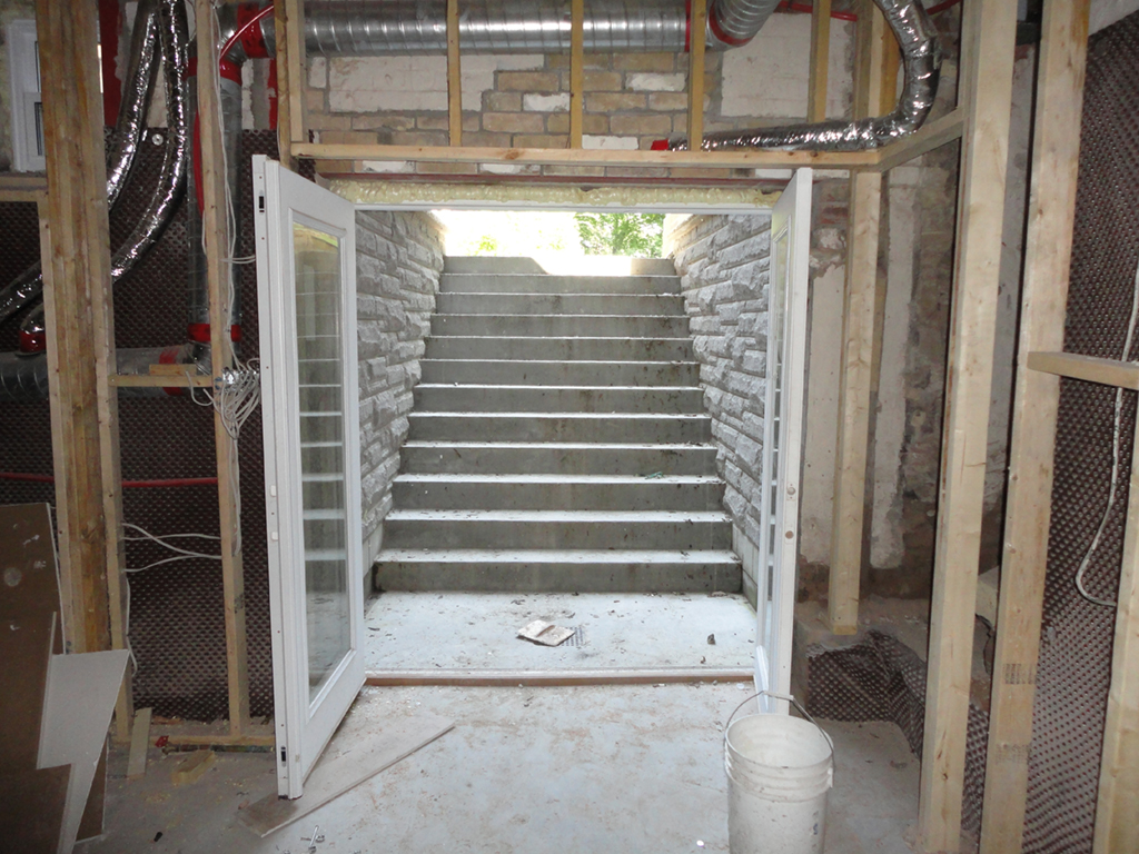 Basement lowering underpinning and basement renovations for Does a walkout basement cost more